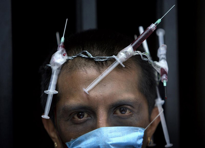 Polo Gomez, 43, wore a crown of needles holding what he said was his own HIV-infected blood during a protest against the increasing prices of AIDS treatment, in Mexico City, on June 18, 2008. Mexico City which hosted the International AIDS Conference.